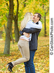 young couple having fun in autumn park