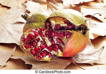 pomegranate fruits - some pomegranate fruits and arils on an...