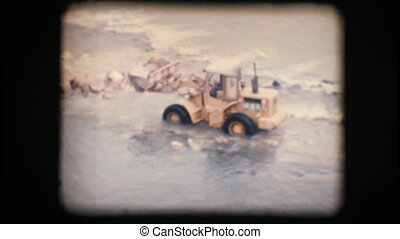 Vintage 8mm. Tractor in a river