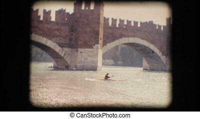 Vintage 8mm. Man kayaking