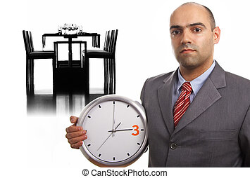 young businessman holding wall clock