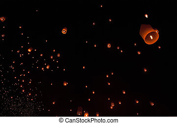 Floating Lantern Loi Krathong - The night sky is engulfed...