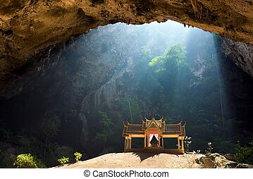 Enchanted cave - Morning sunbeam on golden buddhist pavilion...
