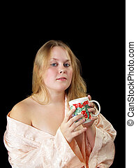 Young plump woman in robe with coffee cup - Young woman in...