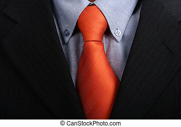tie - detail of a business man suit with orange tie