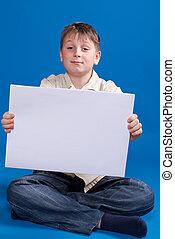 boy holding a blank