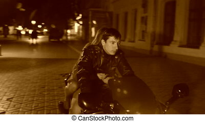 Biker and his girlfriend - Biker giving his girlfriend a...