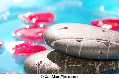 spa stones  closeup on blue water background