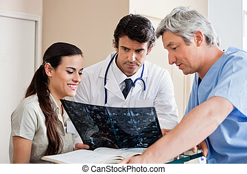 Medical Professionals Reviewing X-ray - Multiethnic medical...