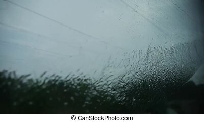 Rain hit glass in rainy season.Speeding train travel,scenery...