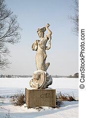 mermaids sculpture in winter