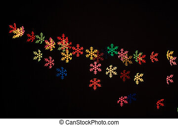 Abstract snow flakes light in black background