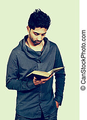 Man Reading a Book - A handsome Arab man reading a book