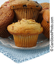 variety of muffins on a plate, bleu tablecloth