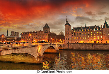 Beautiful colors of Napoleon Bridge at dusk with Seine river...
