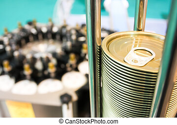 Closeup of can lids in the canning factory