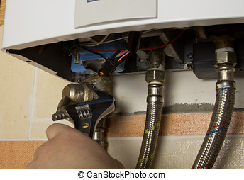 repair of the gas water heater with adjustable wrench -...
