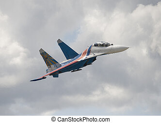 Russian heavy jet fighter in the cloudy sky
