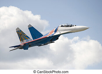 Russian Jet Fighter Su-27 in the cloudy sky