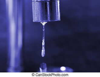 water flowing from the tap - water flowing from a tap focus...