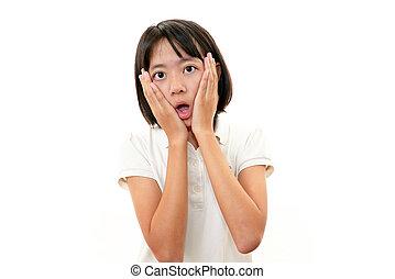 Smiling teen girl - Portrait of an Asian schoolgirl on white...