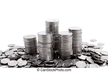 Silver coins are staying in the piles Isolated on white...