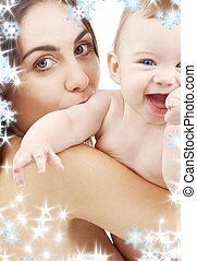 baby boy and beautiful mama - picture of happy mother with...