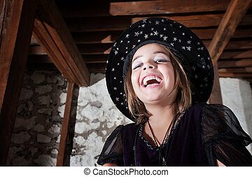 Cute Young WitchLaughing - Laughing European child dressed...