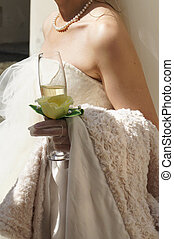 Young beautiful bride - Glass of champagne in the brides...