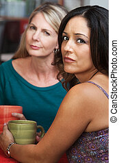 Concerned Ladies in Coffeehouse - Concerned Hispanic and...