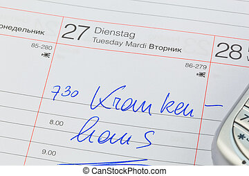 entry in the calendar: hospital - a date is entered in a...