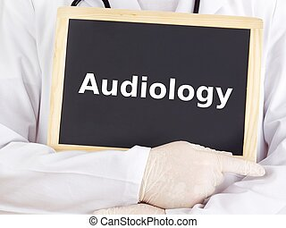 Doctor shows information on blackboard: audiology