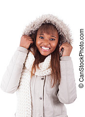 Young african american woman wearing winter clothes,...