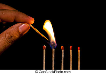 Burning match on black background - Man hand fire a row of...