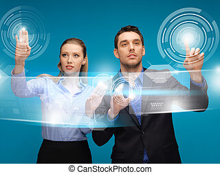 man and woman working with virtual touch screens - picture...