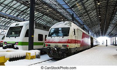 Trains at trainstation at winter - Train sitting at...