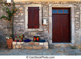 rural house with wooden doorway in greek village(Crete,...