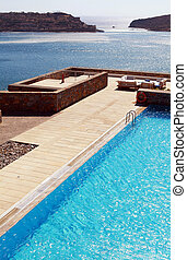 pool and terrace over Mediterranean seaGreece - Vertical...