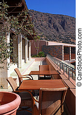 outdoor terrace with chairs and table(Greece)