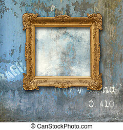 Gold baroque frame on a grunge wall