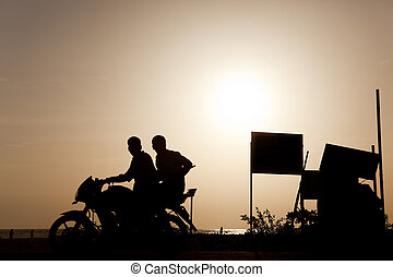 backlighting - Backlight of a motorcycle with two people on...