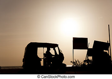 backlighting - Backlight of a rickshaw on the beaches of...