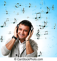 Young handsome man listening music
