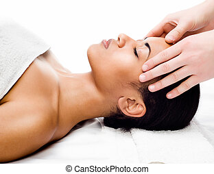 facial massage - Beautiful young woman receiving facial...