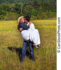 Affectionate Moment in Field - Couple enjoy romantic moment...