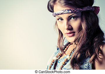 hippie style - Portrait of an attractive young woman in...