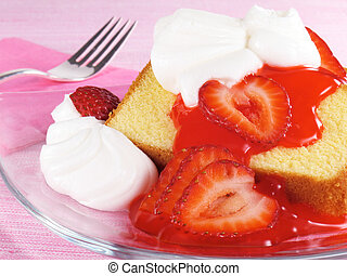 Pound Cake With Strawberries - Sliced pound cake topped with...