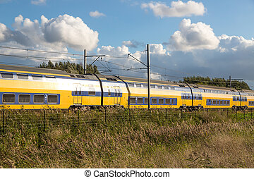 Dutch train in rural landscape