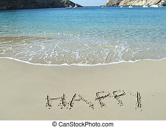 The word Happy written in the sand in Cala Vadella beach in...