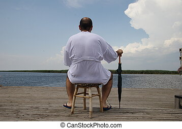 Danube Delta contemplation - sit down man front of the...